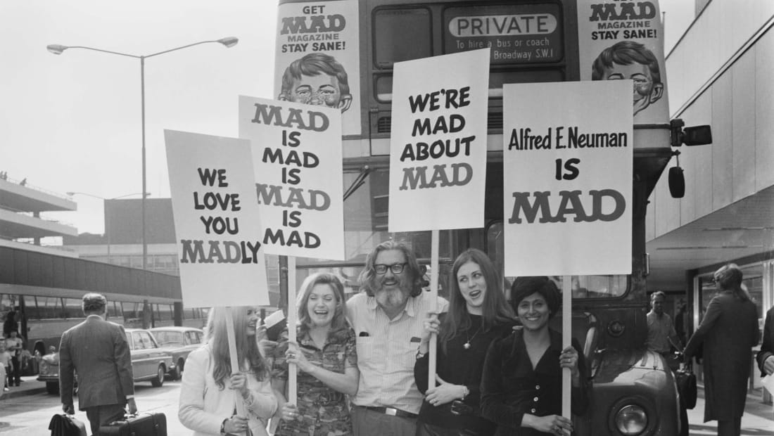 William Gaines, publisher of Mad magazine, arrives at London's Heathrow Airport for a promotional tour in 1971.
