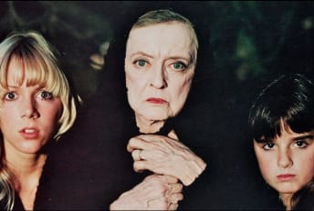 Lynn-Holly Johnson, Bette Davis, and Kyle Richards in The Watcher in the Woods (1980).