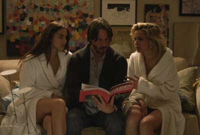 Lorenza Izzo, Keanu Reeves, and Ana de Armas in Eli Roth's Knock Knock (2015).