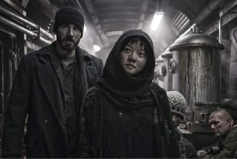 Chris Evans and Ko Asung in Snowpiercer (2013)