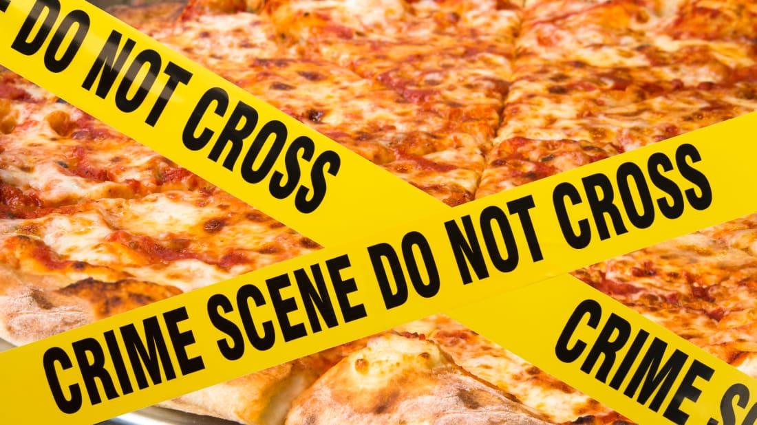 Photo illustration by Mental Floss. Images: istock.com/Michael Burrell (crime scene tape), istock.com/littleny (pizza)