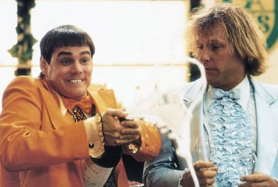 Jim Carrey, one hideous bowl cut, and Jeff Daniels star in Dumb and Dumber (1994).
