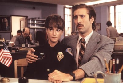 Holly Hunter and Nicolas Cage star in the Coen Brothers' Raising Arizona (1987).