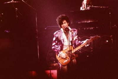 Prince performs during the Purple Rain tour in 1985.