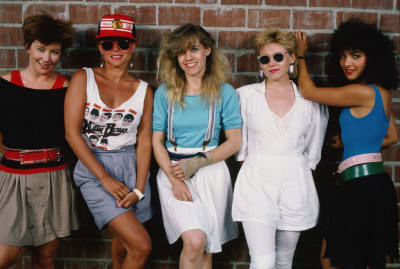 (L to R): The Go-Go's—Gina Schock, Belinda Carlisle, Charlotte Caffey, Kathy Valentine, and Jane Wiedlin—pose during a 1985 photo shoot in Hollywood.