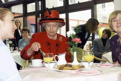 Queen Elizabeth II at an afternoon tea event in 1999.