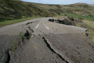 Earthquakes don't cause giant cartoonish chasms to open up, but they can tear up the landscape like this.