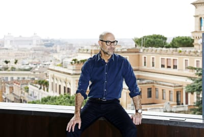 Stanley Tucci feels right at home being photographed at Rome's Hotel Eden.