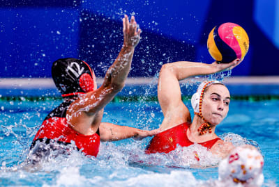 Players from Canada and Spain face off during an Olympic match on July 26, 2021.