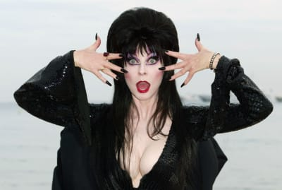 Cassandra Peterson, better known as Elvira, poses during the 2003 Cannes Film Festival.