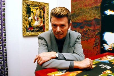 David Bowie at his first solo art exhibition in London in the 1990s.