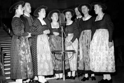 The von Trapp family performs on a London radio show in December 1937.