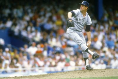 Notable southpaw Tommy John pitching for the New York Yankees in the 1980s.
