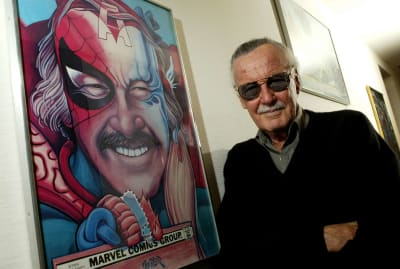 Stan Lee next to a portrait of himself in his Beverly Hills office, 2004.