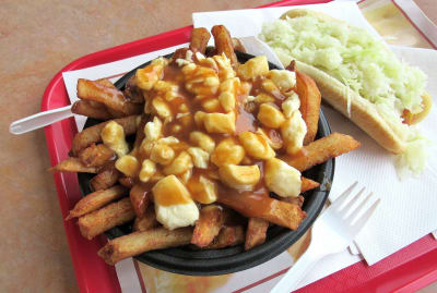 You don't have to be in Quebec to tuck into a plate piled with poutine.
