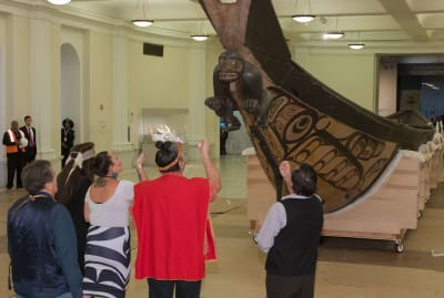 From left to right: Kaa-xoo-auxc (Garfield George), Jisgang (Nika Collison), Megan Humchitt, Haa'yuups (Ron Hamilton), and Chief Wigviłba Wákas (Harvey Humchitt) performing traditional ceremony before the move of the Great Canoe at the American Museum of Natural History in New York.