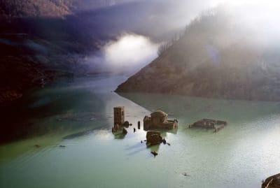 Fabbriche di Careggine peeking over the surface of the lake in Tuscany, Italy.