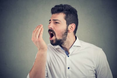 Hands are built-in tools for detecting bad breath.