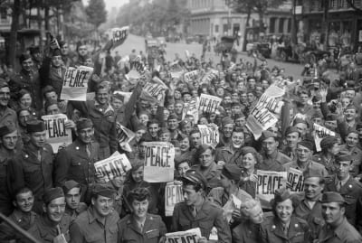 American servicemen and women in Paris celebrate on V-J Day, marking the end of World War II.