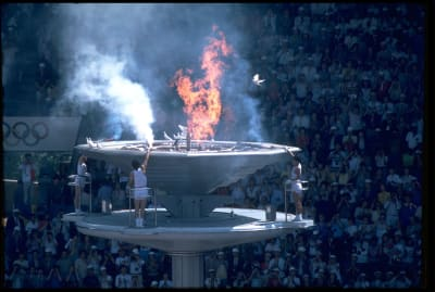 Torchbearers light the Olympic torch at the 1988 Olympic Games in Seoul, South Korea.
