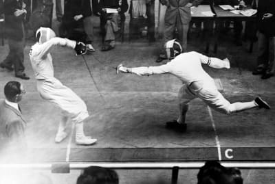 Two swordsmen participating in the fencing semifinals during the 1948 Summer Olympic Games in London.