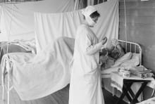 An actual nurse tends to a patient during the 1918 influenza pandemic.