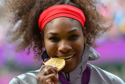 Serena Williams poses with her gold medal after winning at the 2012 London Olympics.