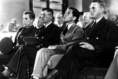 """""""Lucky"""" Luciano (third from left) during his trial in August 1936."""