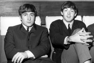 John Lennon (left) and Paul McCartney (right) from The Beatles.