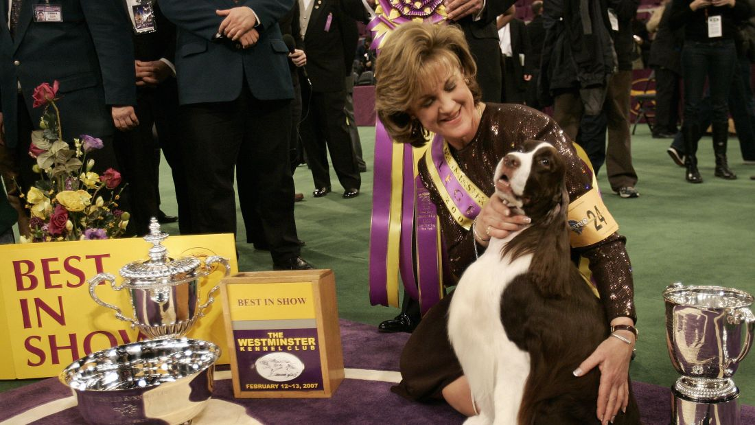 Dog handler Kellie Fitzgerald poses with her English Springer Spaniel 'James' after winning Best in Show at the Westminster Kennel Club's Dog Show in 2007