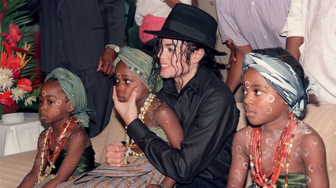 Michael Jackson sits with orphaned and abandoned Ivory Coast children he invited to the Intercontinental Hotel in Abidjan on February 16, 1992.