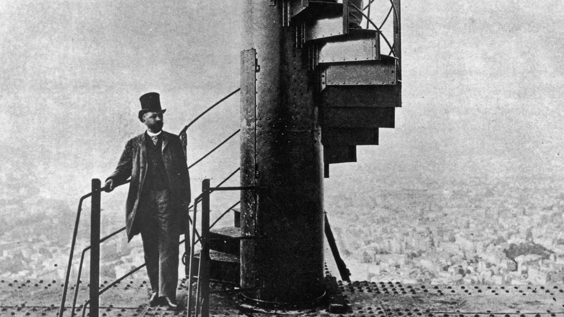 Alexandre Gustave Eiffel (left) stands on the Eiffel Tower staircase in this 1889 photo.