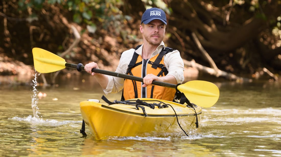 Actor and singer Derek Hough kayaks through Indiana Dunes National Park (formerly National Lakeshore) in September 2017.