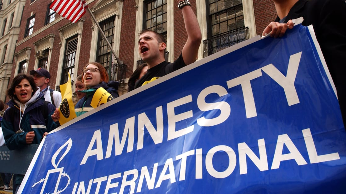 Hundreds of high school students demonstrate April 8, 2002 in front of the Russian Consulate as part of Amnesty International's National Week of Student Action in New York City.