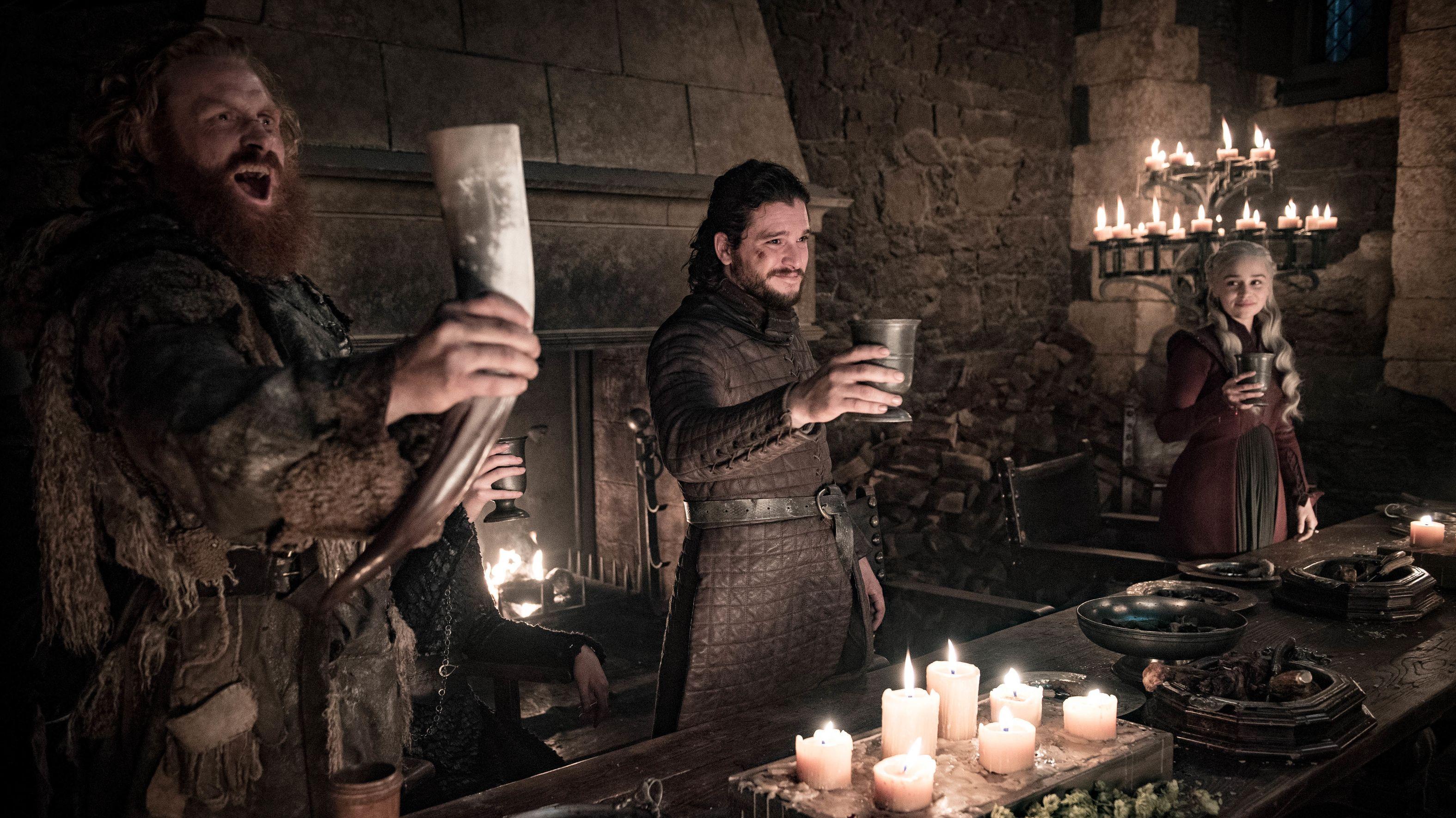 Kristofer Hivju, Kit Harington, and Emilia Clarke celebrate in Game of Thrones