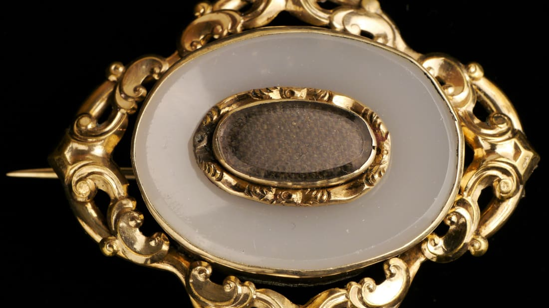 A Victorian mourning brooch made with hair