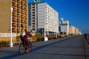 Biking along the boardwalk in Virginia Beach, Virginia.