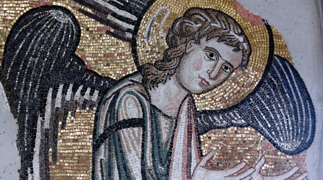 An ancient angel mosaic on a wall of the Church of the Nativity