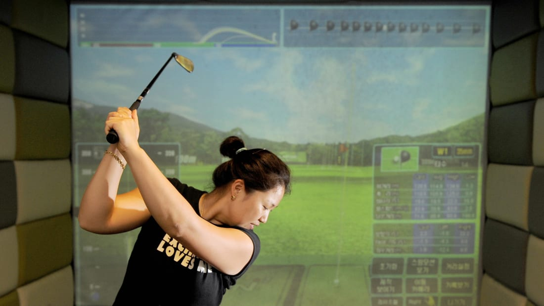 A virtual reality golf game is played in South Korea.