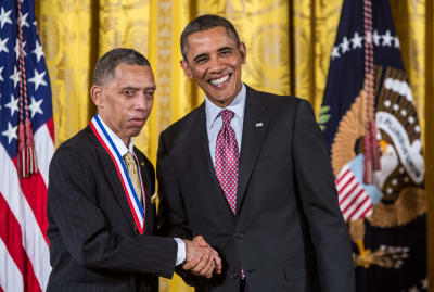 President Barack Obama presents George Carruthers with the National Medal of Technology and Innovation in February 2013.