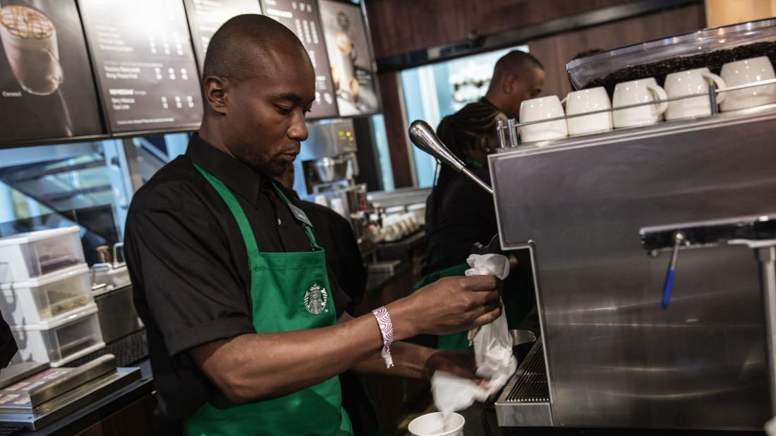 A Starbucks employee hard at work