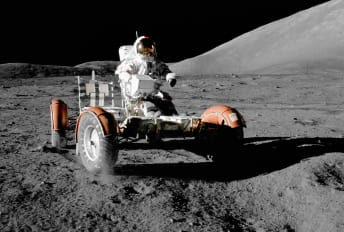 Astronaut Eugene A. Cernan mans a Lunar Roving Vehicle during the Apollo 17 mission.