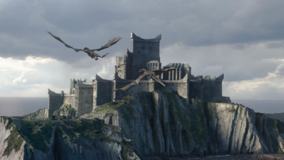Drogon and Rhaegal flying over Dragonstone in HBO's Game of Thrones.