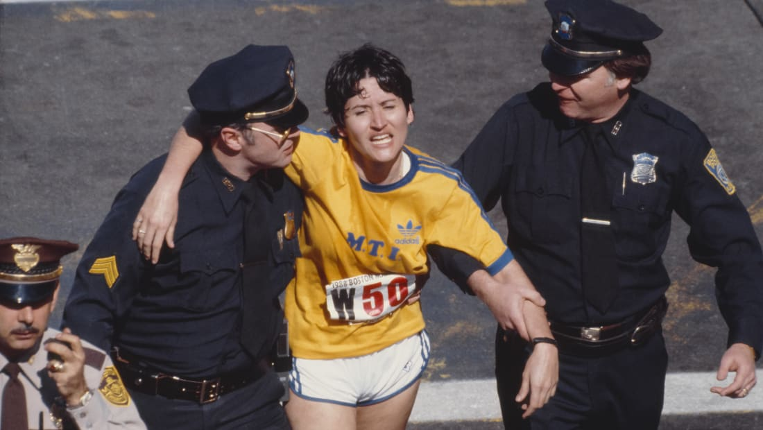 Rosie Ruiz is shown moments after crossing the finish line as the apparent women's race winner of the 84th Boston Marathon in 1980.