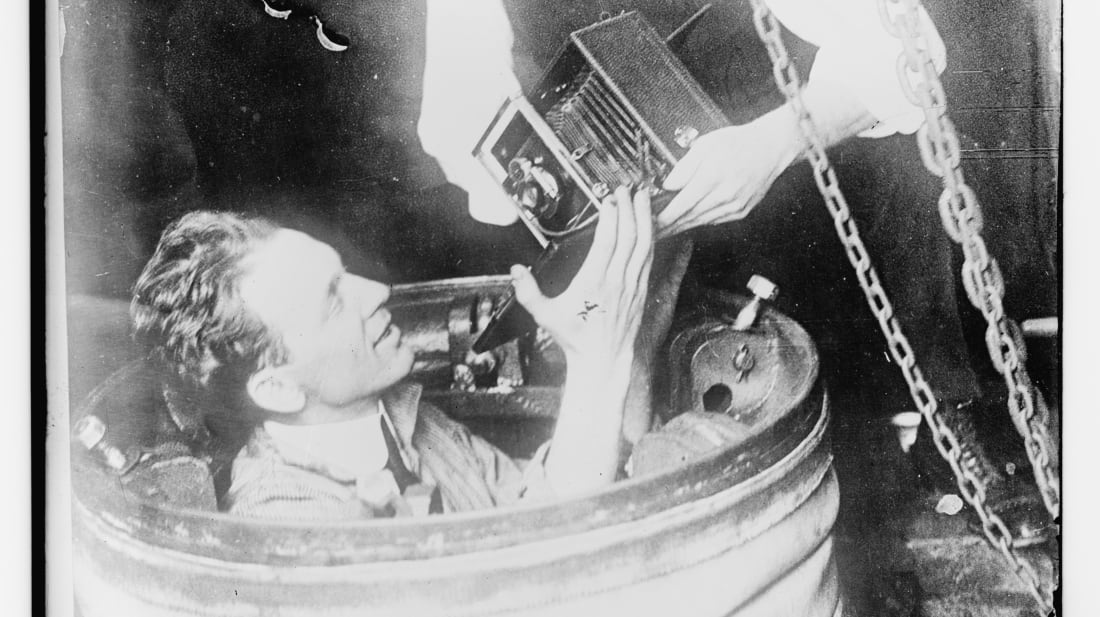 Journalist and documentarian J.E. Williamson descends into a photosphere to film underwater footage.
