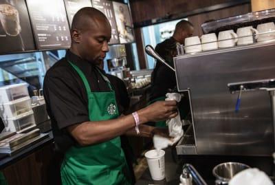 A Starbucks employee hard at work