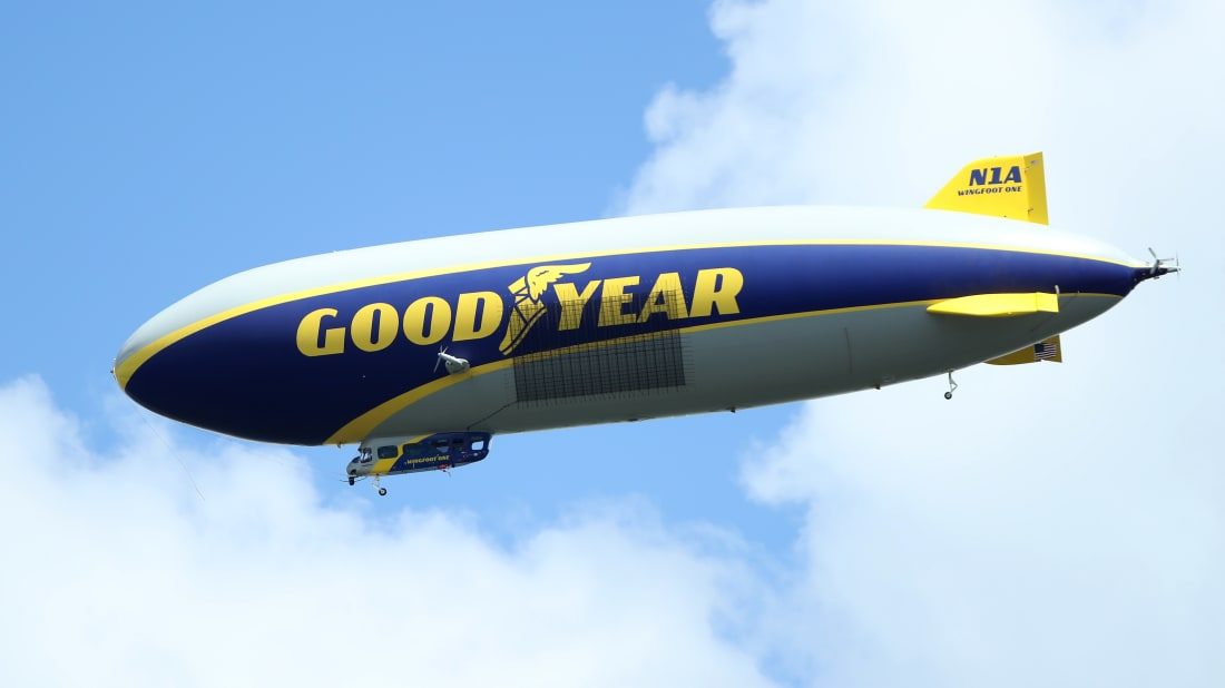 The goodyear blimp flies over the course at the PGA Championship.