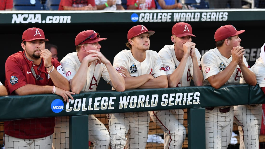 Arkansas Razorbacks look on from the dugout as they loose to the Oregon State Beavers.