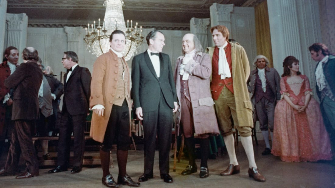 "President Richard Nixon with the cast of the musical 1776 after a performance in the East Room of the White House in 1970. Nixon lobbied to have the song ""Cool, Considerate Men"" removed from the show; he finally succeeded when a prominent campaign supporter of his produced the movie version and had the footage deleted."