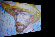 A self-portrait of Vincent Van Gogh is displayed on a screen in Rome in 2016